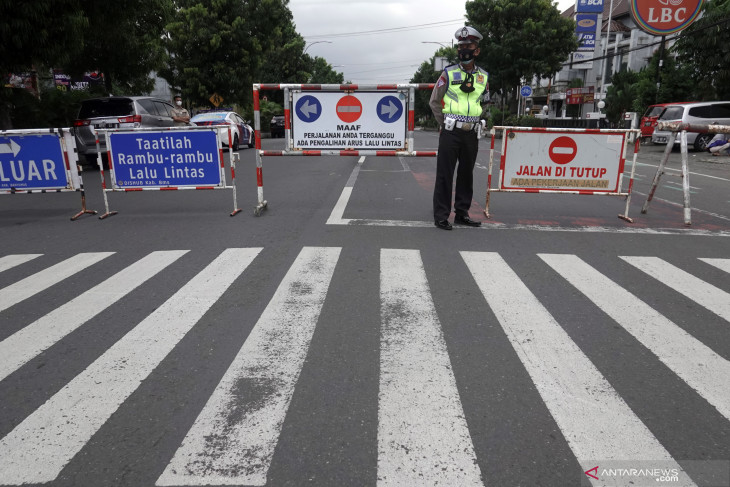 Faced with rising infections, Indonesia doubles down on restrictions