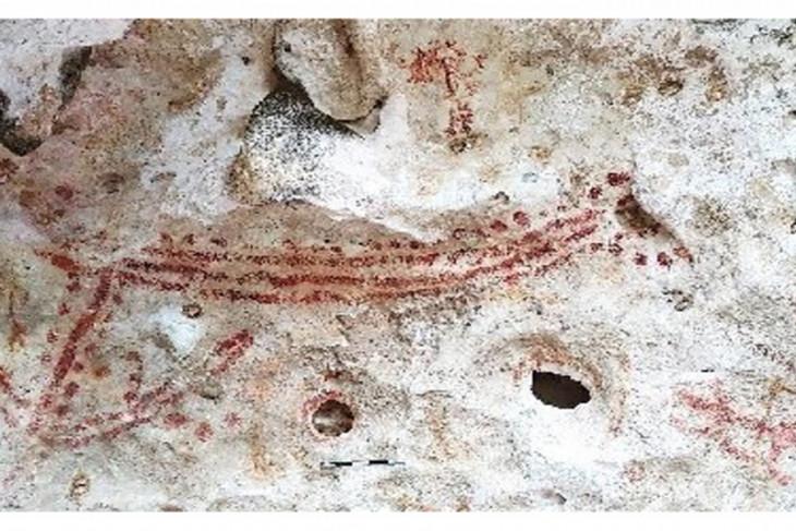 Gambar cap tangan purba tanpa jari telunjuk ditemukan di  Maluku