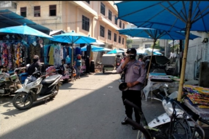 Polres Tebing Tinggi sosialisasi bahaya COVID-19 di sejumlah pasar tradisional