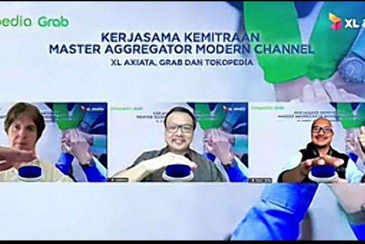 XL Axiata kerja sama Grab dan Tokopedia tingkatkan kualitas layanan