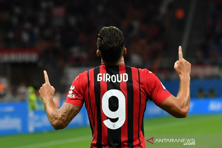 Olivier  Giroud buka tabungan gol kala bantu AC Milan lahap Cagliari 4-1