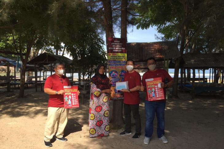 Dukung percepatan pemulihan ekonomi, FK IJK Aceh bagikan masker di lokasi wisata