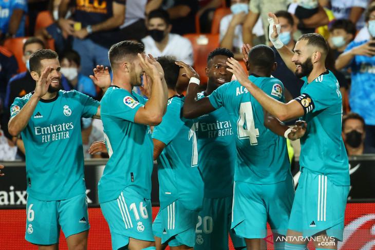 Gol larut Benzema dan Vinicius bantu Madrid bangkit lawan Valencia