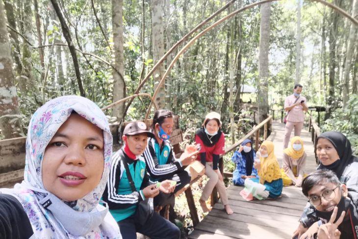 Menjaga karbon lewat pengelolaan hutan gambut Sungai Buluh