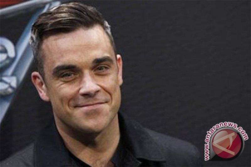 Robbie Williams dilarang nyanyikan lagu andalanya di pembukaan Piala Dunia