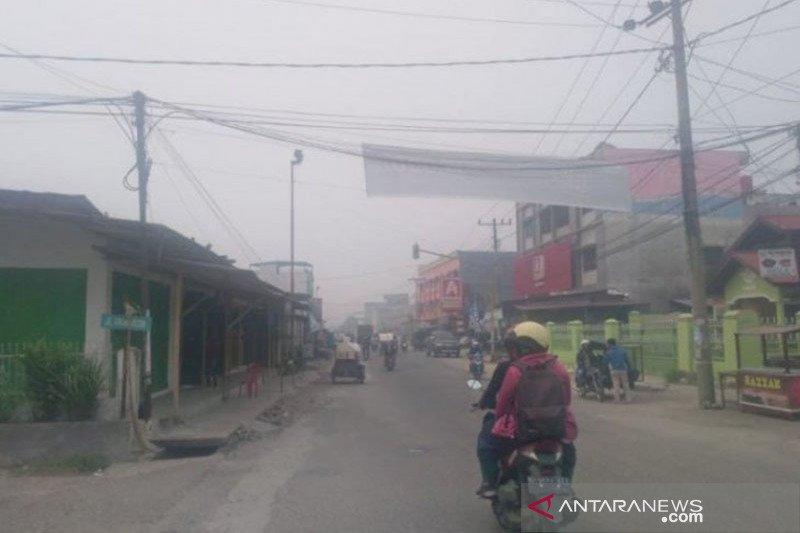 Kabut asap masih selimuti tiga daerah meski hujan turun