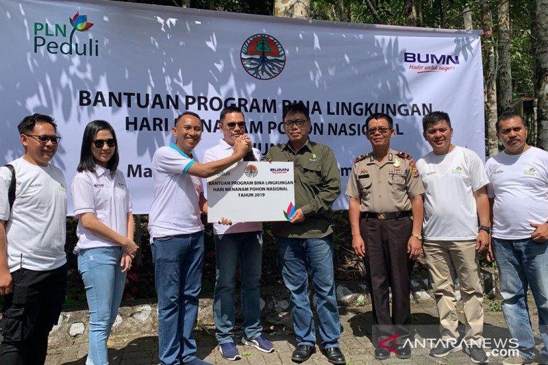 PLN Suluttenggo tanam ribuan pohon di lokasi wisata Mahawu peringati HMPI
