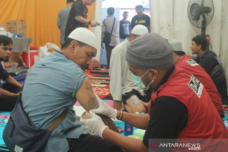 Mahtan menggelar penghapusan Tatto gratis di HUT DTT-SMDE Polda Sultra