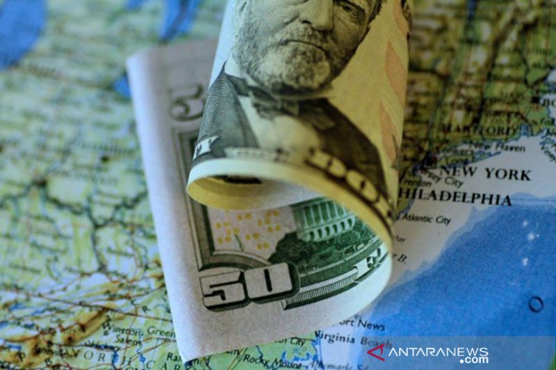 Dolar turun tapi catat kenaikan mingguan di tengah kekhawatiran virus
