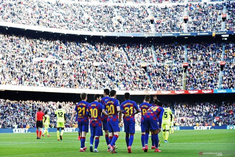 Pemain Barcelona siap potong gaji karena corona