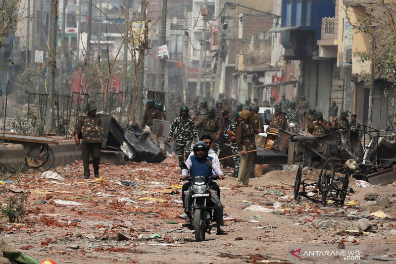 Di ibu kota India, kerusuhan perdalam  perpecahan antara Hindu, Muslim