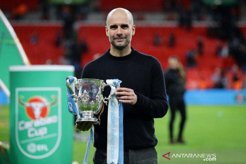 Pep Guardiola tidak mau buru-buru klaim bisa juarai Piala FA