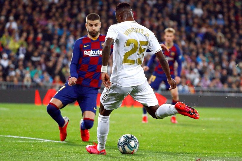 Real Madrid puncaki La Liga setelah tundukkan Barcelona 2-0