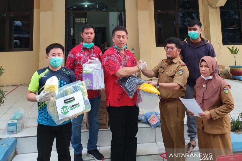 Paguyuban Marga Tionghoa Sulteng bantu alat perlindungan medis COVID-19