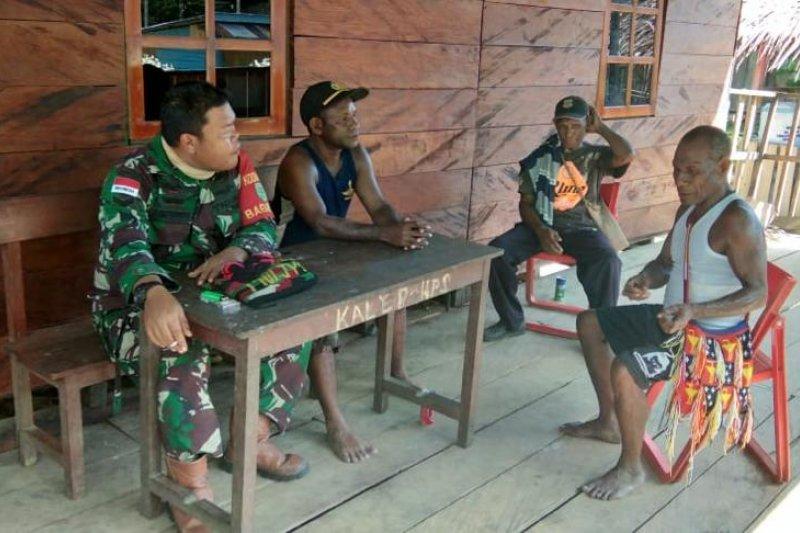 Satgas TMMD sosialisasikan pencegahan virus corona pada warga Kampung Kibay