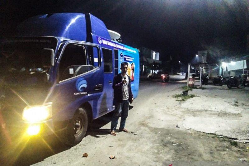 Dinas Kominfo Kampar sosialisasi bahaya corona ke pelosok desa
