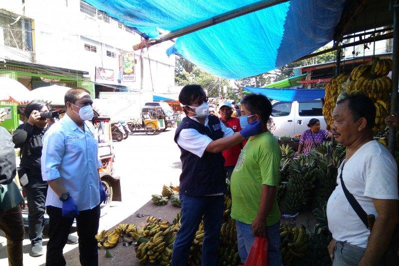 PMI Makassar bersama berbagai lembaga sosialisasi cegah COVID-19 di pasar