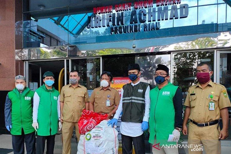 UAS distributes over 400 hazmat suits to hospitals