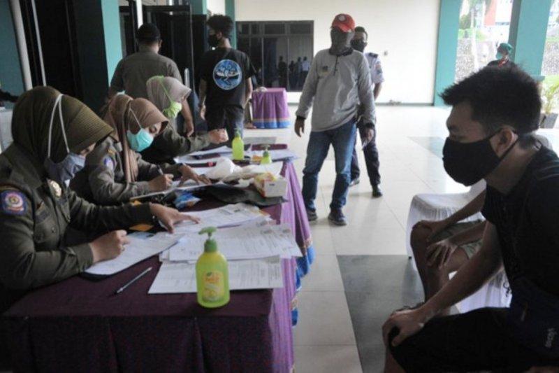Sejak penerapan disiplin masker sudah180 pelanggar di karantina di Asrama Haji Palembang