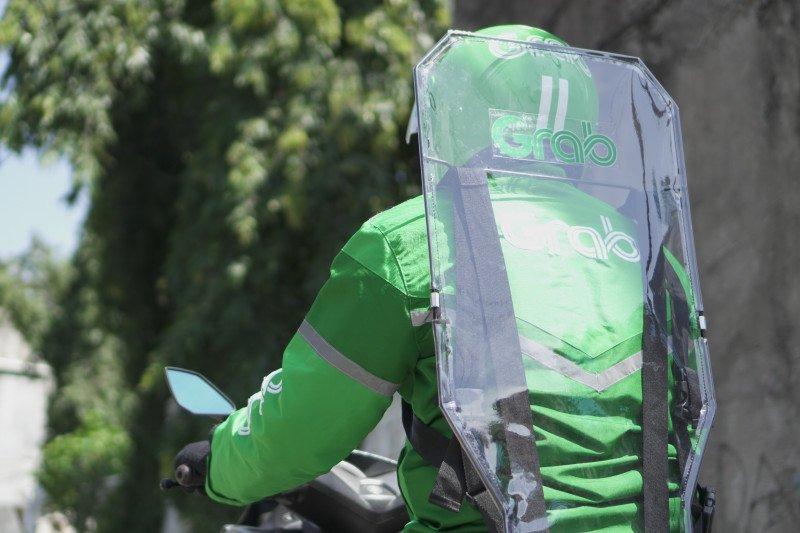 Grab Bersama OTO Group bantu ringankan angsuran mitra pengemudi
