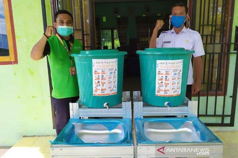 WVI salurkan fasiltas cuci tangan cegah COVID-19 di Touna