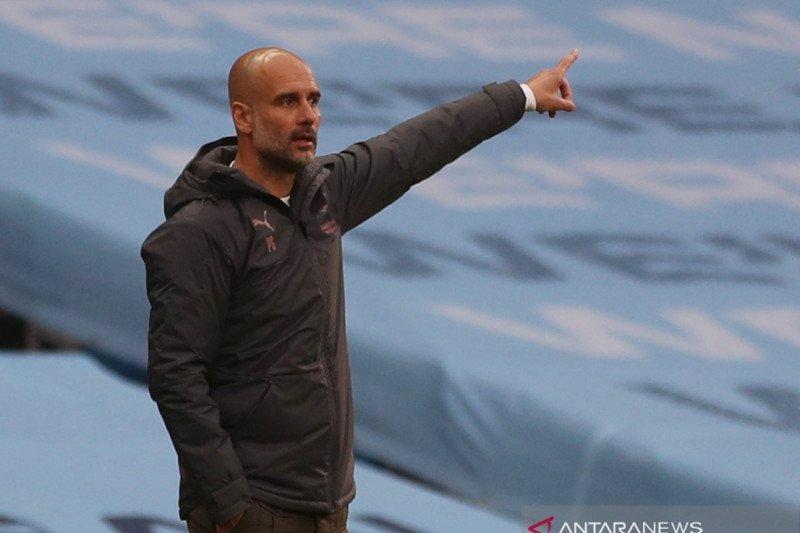 Pep Guardiola: lebih penting jadi runner up liga dibandingkan juara FA