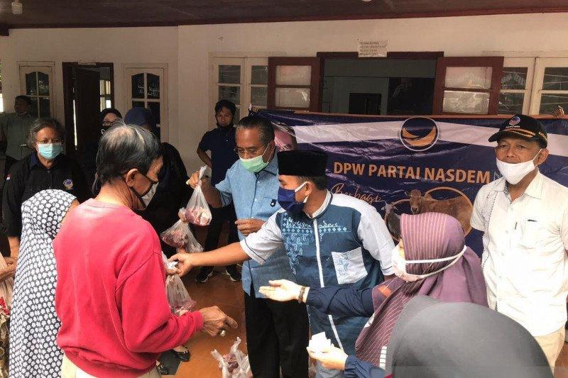 DPW Partai NasDem NTB menyalurkan 200 paket daging kurban