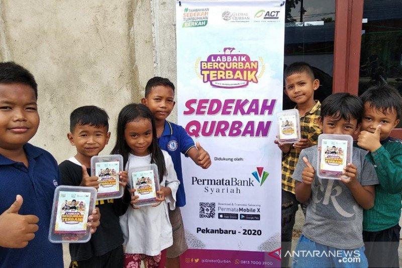 Global Qurban-ACT Riau bersama Bank Permata Syariah salurkan kurban di Dusun IV Kasang Kulim Kampar