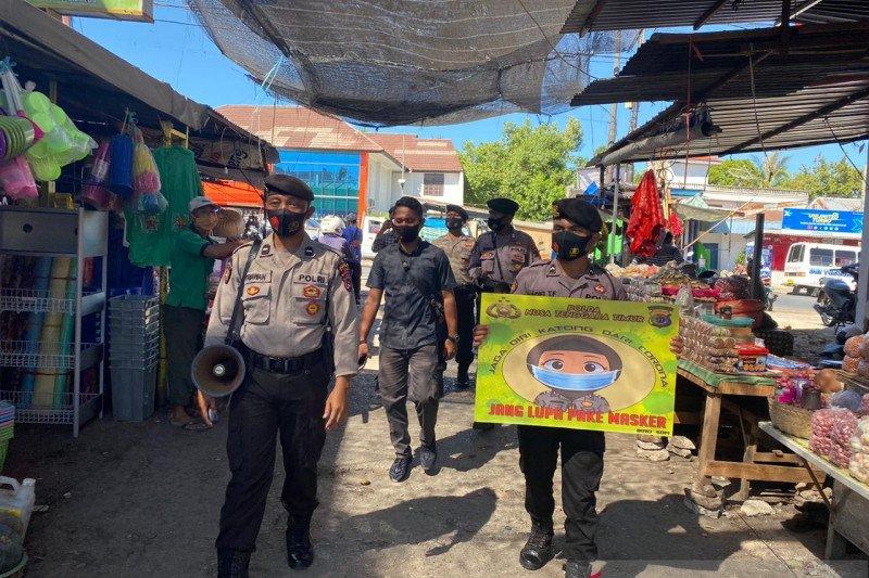 Polisi imbau warga Kota Kupang di pasar tradisional gunakan masker