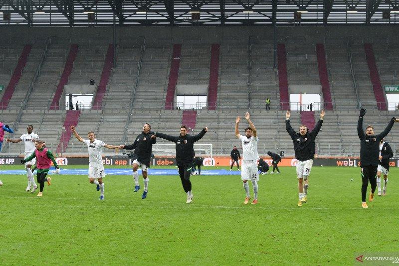 Liga Jerman: Augsburg untuk sementara nyaman di puncak