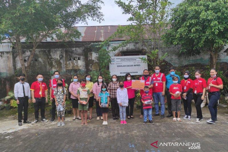 Alfamart-Mizan Amanah salurkan  bantuan pendidikan di Minahasa Tenggara