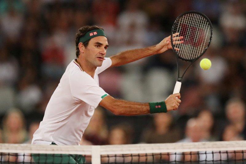 Federer tundukkan Evans dalam laga pertama setelah absen 14 bulan