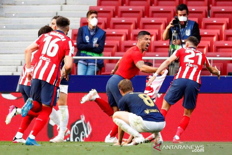 Atletico Madrid tetap puncaki klasemen usai menang dramatis
