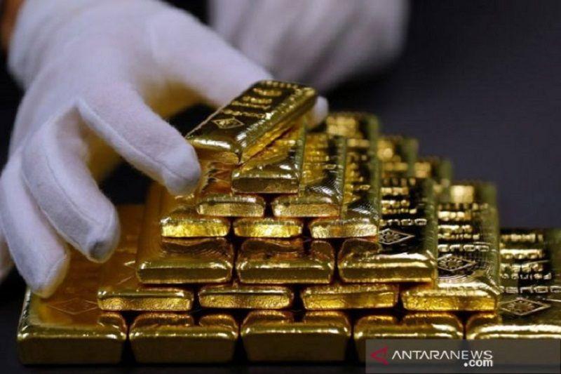 Harga emas anjlok